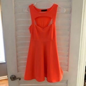 Orange mini dress with a cut out above the chest